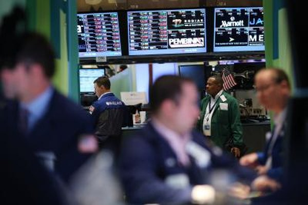 The taking of long and short positions is all part of a day's work for these traders on the floor of the New York Stock Exchange in July 2012.