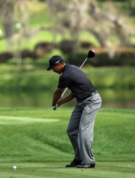 Tiger Woods lets his arms drop first in his downswing, then he turns his shoulders.