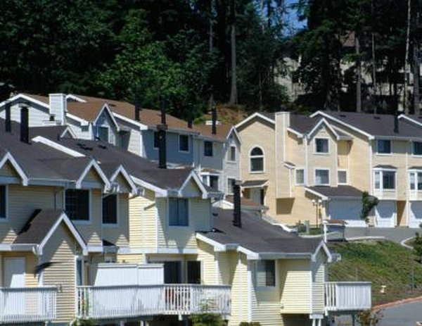 Attached housing typically requires a homeowner's association to oversee shared areas.
