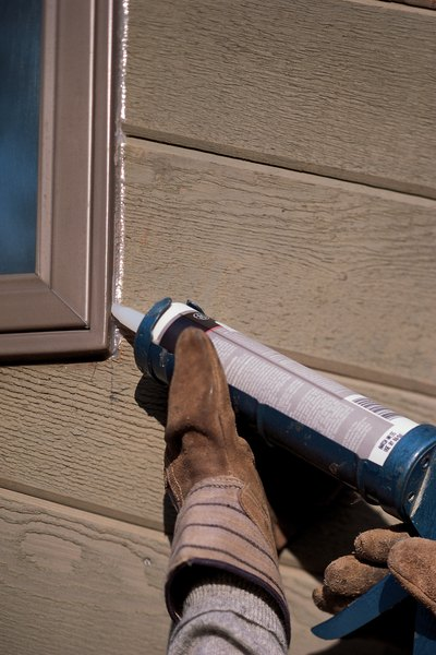 Installing vinyl windows on brick houses home guides sf gate for Best caulk for exterior window trim