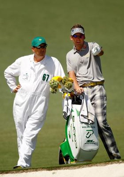 Caddie Terry Mundy (left) helps Ian Poulter plan a shot during the 2012 Masters.