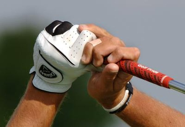 PGA Tour golfer Charles Howell III uses a standard overlapping grip with his right pinkie resting on his left hand.