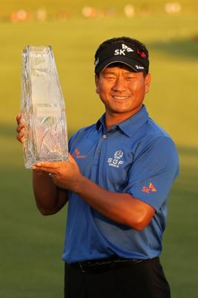 K.J. Choi displays his trophy after winning The Players Championship in 2011.