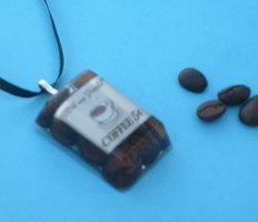 Coffee beans and paper sealed in polyresin.