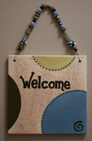 Welcome signs are a decorative way to welcome guests.