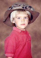 A child wearing a safari hat.
