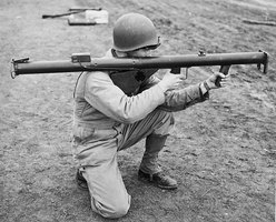 A soldier using a bazooka during World War II