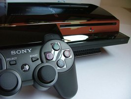 A Playstation 3 with a wireless controller.