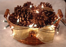 Pinecones and mini lights gently illuminate a cozy fall or winter evening.