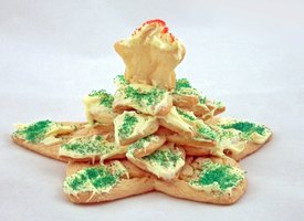 Young children can assemble a Christmas star cookie tree mostly on their own.