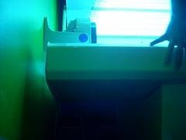 Pros & Cons of a Tanning Bed