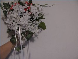 Small flower cascade petite bride bouquet.