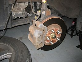 change brake pads on a Honda Pilot