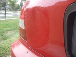 A dent in the back passenger's side panel of a Honda Civic