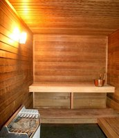 A sauna can be built in an unused basement room or closet.