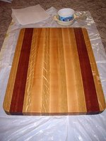 A butcher block cutting board made with different types of hardwood.