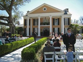 Guests arrive for a Southern wedding at a Southern plantation.
