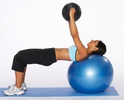 Get flat abs by using stability and medicine balls.