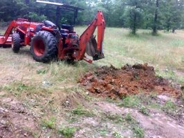 Additional traction gained from adding water to tractor tires is a plus when digging or carrying heavy loads