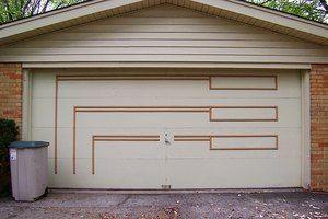 Creative garage door designs give individuality to a house and the people who dwell inside.