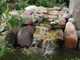 Attractive backyard waterfalls can be pondless.