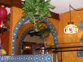 Open archways create an authentic Mexican look in any room.