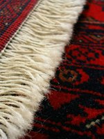 A damaged rug fringe may be replaced with a new one.