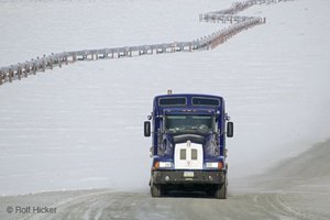 Use confidence while driving large trucks in icy weather.