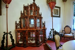 An elaborate curio cabinet in Edinburgh holds china.