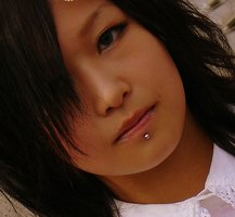 A young woman with a labret piercing