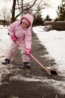 Shovel snow and de-ice sidewalks to prevent walkways from becoming slippery.