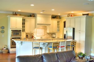 Light up the cabinets in your home with recessed lighting.