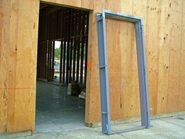 doors are framed within the wall frame and can be adjusted if warped