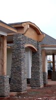 Real and faux stone and brick can transform a home's exterior style.