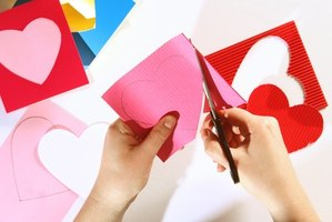 Cut out hearts to use in the heart matching game.