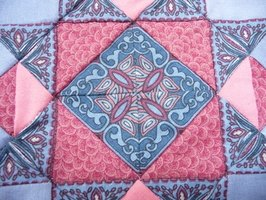 Remove old blood stains on a quilt with careful cleaning.