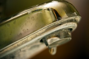 Remove water stains immediately from chrome faucets to prevent permanent staining.