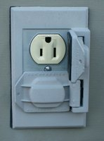A regular receptacle, housed in a weatherproof outlet box.