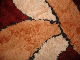 Restore a carpet's soft feel by removing dried on fabric glue