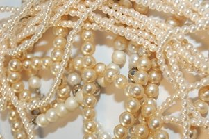 Imitation pearls can be identified through a variety of methods.