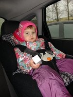 Child safety seats position children properly in a car.