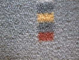 Painting an indoor/outdoor carpet can improve its appearance