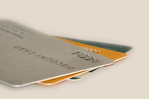 Debt settlement agreements allow you to pay off your cards for less than what you owe.
