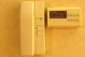 A programmable thermostat is the way to go.
