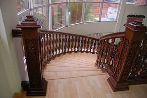 Staircase covered in hardwood
