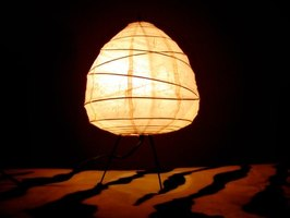 A Japanese lamp shade has irregular spiral wires inside and a paper covering.