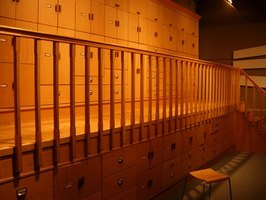 An archivist works in a facility that holds preserved documents and records.