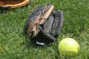 A softball is larger and slightly softer than a baseball.