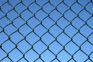 Start chain link fence installation with the gates, if possible.