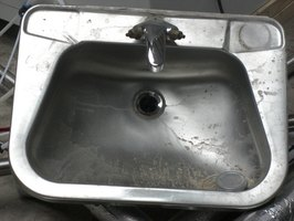Polishing an old stainless-steel sink can make it look like new again.